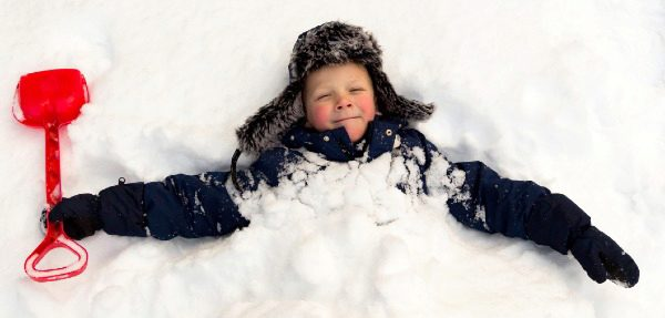 boy smiling in the snow